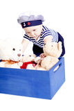 Cute little baby in sailor fashion playing Royalty Free Stock Photos