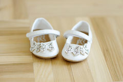 Cute little baby shoes on a floor Royalty Free Stock Image