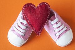 Cute little baby shoes. Sneakers for baby on the colorful background Royalty Free Stock Image