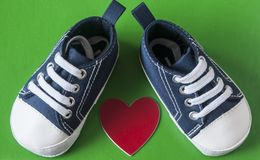 Cute little baby shoes. Sneakers for baby on the colorful background Stock Photography