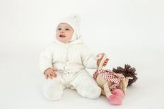 Cute little baby sitting on floor over white background Royalty Free Stock Photos