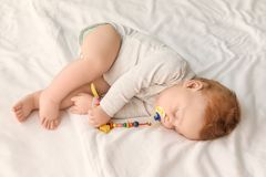 Cute little baby sleeping bed stock photos