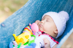 Cute little baby sleeping in the park Stock Photography
