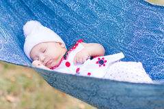 Cute little baby sleeping in the park Royalty Free Stock Image