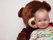 Cute little baby with a stuffed teddy bear. Stock Photos