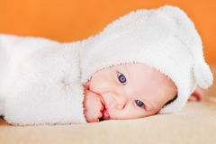 Cute little baby sucking his fingers royalty free stock images