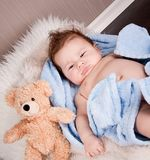 Cute little baby todler infant lying on blanket Royalty Free Stock Image