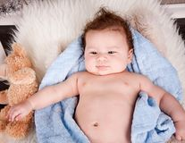 Cute little baby todler infant lying on blanket Royalty Free Stock Photo