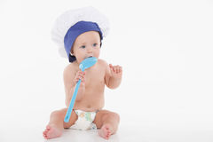 Cute little baby in toque with ladle. Royalty Free Stock Image
