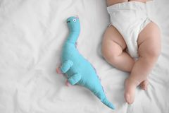 Cute little baby with toy sleeping on bed. At home Royalty Free Stock Image