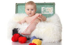 Cute little baby in vintage suitcase Stock Image