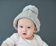 Cute little babyvis wearing a gray hat Royalty Free Stock Images
