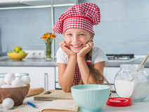 Cute little baker on kitchen Royalty Free Stock Images
