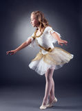 Cute little ballerina dancing in studio Stock Photos