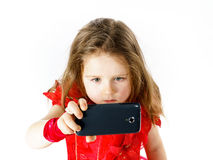Cute  little ballerina dressed in red  taking a selfie photo Stock Photography