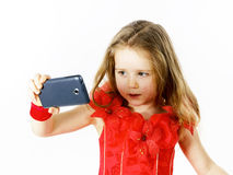 Cute  little ballerina dressed in red  taking a selfie photo Stock Images