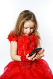 Cute  little ballerina dressed in red  taking a selfie photo Stock Photos