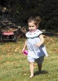 Cute little barefoot girl. Stock Photo