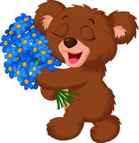 Cute little bear holding a bouquet Stock Photo