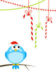 Cute little bird with Christmas candies Stock Images
