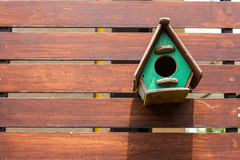 Cute little birdhouses. On wooden fence Royalty Free Stock Image