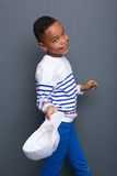 Cute little black boy smiling and holding hat Stock Images