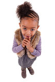 Cute little black girl looking up. Cute little african american girl  looking up Royalty Free Stock Images