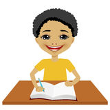 Cute little black student boy writing Stock Images