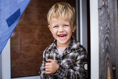 Cute little blond boy laughing. Happiness Stock Images