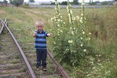 Cute little blond boy playing on railway Royalty Free Stock Photos