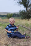 Cute little blond boy playing on railway Royalty Free Stock Photography