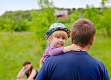 Cute little blond girl being carried by her father Stock Photography