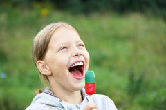 Cute little blond girl eating ice cream Royalty Free Stock Image