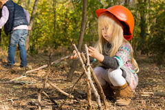 Cute little blond girl in an oversized hardhat Royalty Free Stock Image