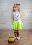 Cute little blond girl vacuuming the house Royalty Free Stock Photography