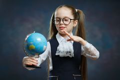 Cute Little Blond Schoolgirl Hold World Globe royalty free stock photo