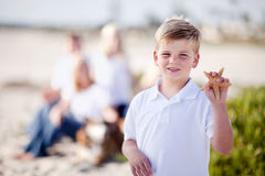 Cute Little Blonde Boy Showing Off His Starfish. At the Beach stock images
