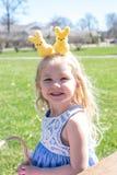 Cute little girl in bunny headband on Easter stock photo