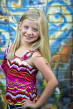 Cute little blonde girl at graffiti wall Royalty Free Stock Photo