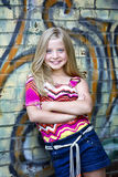 Cute little blonde girl at graffiti wall Stock Photos