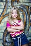 Cute little blonde girl at graffiti wall stock photos