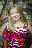 Cute little blonde girl at graffiti wall Stock Photography
