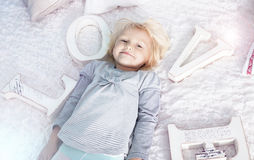 Cute little blonde girl Stock Photos
