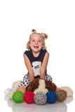 Cute little blonde girl sitting on a big soft dog Stock Photography