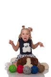 Cute little blonde girl sitting on a big soft dog. Toy on white background Stock Image