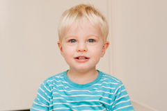 A cute little blue eyed boy Stock Photos