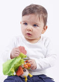 Cute little blue eyed boy with toy Royalty Free Stock Photos