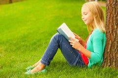 Cute little bookworm. Stock Photography