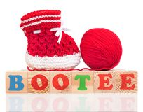 Cute little bootee. Bright cute little bootee with playing cubes  over white background Royalty Free Stock Photography