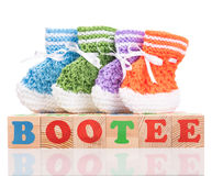 Cute little bootee. Bright cute little bootee with playing cubes isolated over white background Royalty Free Stock Photos